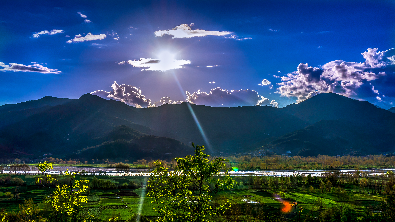 sky-sun-clouds-mountains
